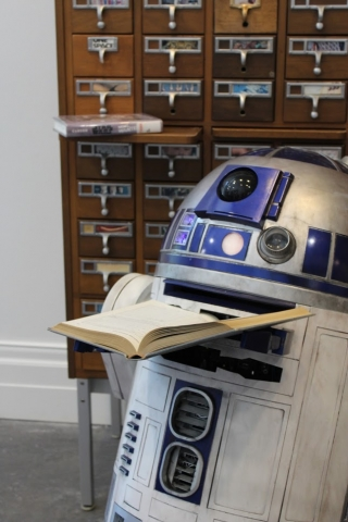 R2D2 searches the card catalog for the perfect book