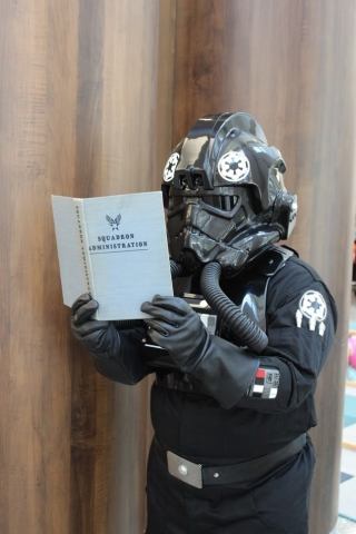 An Imperial pilot reading up on tactics