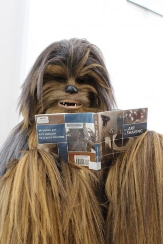 Chewbacca reading a book about shaving