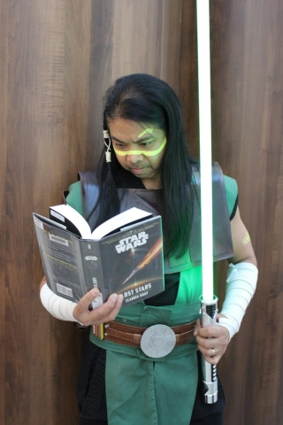 A Jedi Knight reads a Star Wars Book