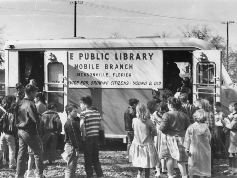 bookmobile with a crowd gathered around