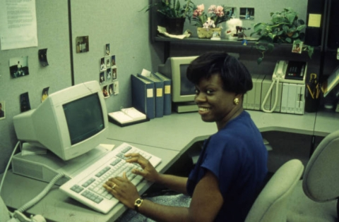 Library employee working on computer