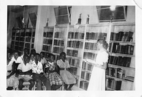 Students and teacher in a library