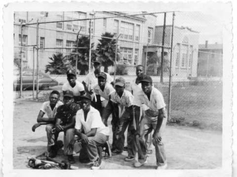 young men posing after baseball