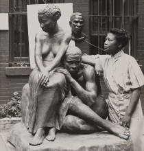 Image of the artist Augusta Savage with her sculpture, photo is part of the African-American collection at the Jacksonville Public Library