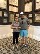 Jenna Hassell with Patrick Lane in the Ansbacher Map Room. Jenna is wearing the Aira glasses and holding the hotspot that goes with it
