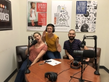 Hurley and Jenna pretend to sing in the microphones with Josh Cobb in the podcast studio at the main library