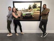 Jenna and Hurley with photographer Malcolm Jackson, in front of one of his photos in the Jax Makerspace Gallery exhibit
