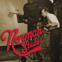 Norman Studios logo with camera operator and camera