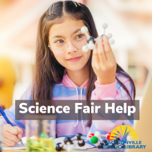 girl working on her science fair project