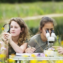 kids with a magnifying glass and microscope