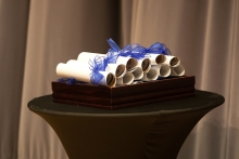 rolled up diplomas on a table