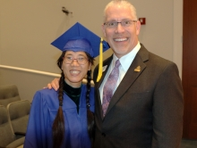 Lianying Ye gets a big congratulations from Library Director Tim Rogers at the Jacksonville Public Library