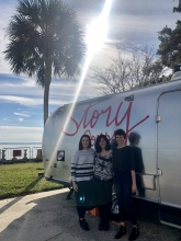 Jenna and Hurley with Jacqueline Van Meter in front of the StoryCorps bus